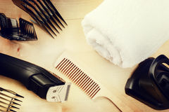 Setting with hair clipper and wooden comb. Beauty and haircare b. Ackground with copyspace royalty free stock photos