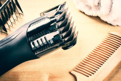Setting with hair clipper and wooden comb. Closeup shot stock photos