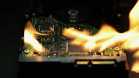 Setting a hard disk on fire stock footage