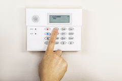 Setting Home Alarm System Stock Photography