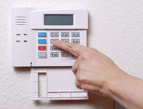 Setting the House Alarm royalty free stock photography
