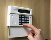 Setting an intruder alarm Royalty Free Stock Images