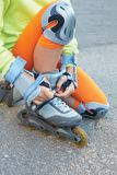 Setting of laces on black roller skates. Stock Photos