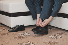 Setting of laces on boots 1017. Stock Image