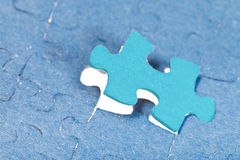 Setting the last new piece of puzzle Stock Photos
