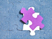 Setting the last pink piece of puzzle Royalty Free Stock Photo