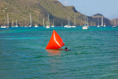 Setting a marker for a swimming race in admiralty bay Royalty Free Stock Photo