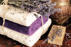Setting with natural soap, towels and lavender Stock Photography