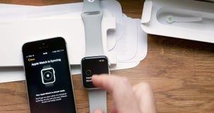 Setting new Apple Watch wearable smartwatch computer. PARIS, FRANCE - CIRCA 2018: Sun flare sunlight POV man unboxing unpacking latest Apple Watch Series 3 GPS stock footage
