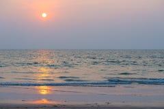 Setting orange sun and sea Stock Photos