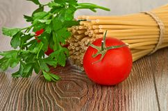 Setting pasta with tomato and garlic Stock Images
