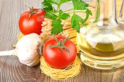 Setting pasta with tomato and garlic Royalty Free Stock Image