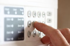 Setting security alarm A Royalty Free Stock Photo