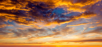 Setting summer sun with fluffy clouds. Setting summer sun, sunset theme for your project Royalty Free Stock Images