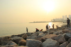 The Setting sun ,Silhouette and Golden coastline in SHENZHEN,CHINA ,ASIA Royalty Free Stock Photos
