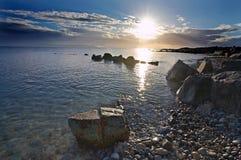 Setting Sun. Bright sun sinks to horizon on Galway Bay, Co.Galway, Ireland Stock Photography