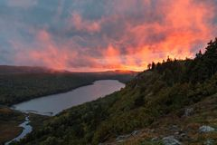 Lake of the Clouds Sunset, Porcupine Mountains Wilderness Area,. A setting sun backlights rising fog with vivid colors over Lake of the Clouds, at Porcupine Stock Image