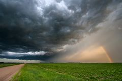 Sunset Casting Light on a Departing Thunderstorm royalty free stock photography