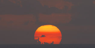 Setting sun with clouds. Tropical sun set over the Caribbean sea with clouds Stock Photo