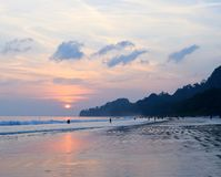 Setting Sun with Colorful Sky at Crowded Radhanagar Beach, Havelock Island, Andaman, India. This is a photograph of golden sunset over ocean... The image is stock photos