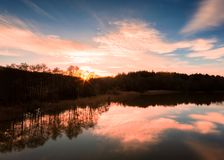 Setting sun creating silhouette, gothenburg sweden. Kungalv and gota river royalty free stock image