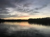Sunset at Fowl River Alabama. Setting sun with a few clouds at Fowl River Alabama Royalty Free Stock Photos