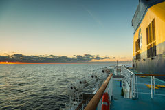 Setting sun on funnel of Corsican Ferry Royalty Free Stock Images