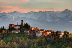 Langhe - The village of Rocca Ciglié and Alps. Royalty Free Stock Images