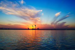 Setting sun lakeside Stock Photo