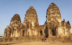 Setting Sun Light on Phra Prang Sam Yord. Evening sun light falls golden on Phra Prang Sam Yord wat, or monkey temple in Lopburi, northern Thailand Royalty Free Stock Images