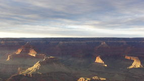 The setting sun lights up the far walls of the Grand Canyon. Royalty Free Stock Image