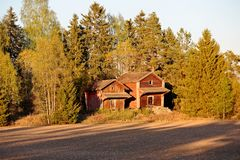 Old barns near fields in the evening light royalty free stock photography