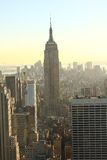 Setting sun Manhattan. The Empire State Building with Manhattan's skyline in the setting autumn sun. Shot in November 2010 Royalty Free Stock Image