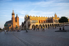 Setting sun on the Mariacki Basilica and the Cloth Hall on Market Square in Krakow Poland Stock Photography