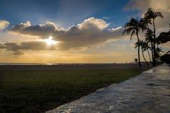 Setting sun over beach at Ala Moana Park Royalty Free Stock Image