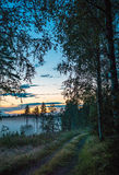 Setting sun over country landscape, Renko, Finland Royalty Free Stock Photos