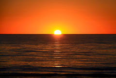 Setting Sun over Ocean, Australia. Setting Sun over Larg's Bay Beach, Adelaide, Australia Royalty Free Stock Photography