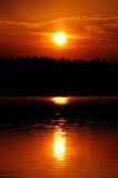 Setting Sun with Ray Path of Light on Water Royalty Free Stock Photos