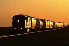 Setting sun reflecting off train Royalty Free Stock Images