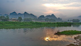 The setting sun seems to sublime. This is a small guilin said the RongJiang Royalty Free Stock Photos