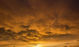 Sunset with rare yellow colors and mostly clouded sky royalty free stock image