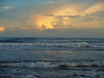 Evening Glow at Atlantic Beach, North Carolina. Setting sun shines off of the waves and water in Atlantic Beach, North Carolina Stock Image