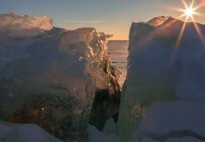 Setting sun shines through the transparent blocks of ice. Stock Photo
