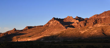 The setting sun shone on the mountains Stock Image