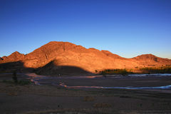 The setting sun shone on the mountains Royalty Free Stock Image