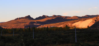 The setting sun shone on the mountains Royalty Free Stock Photography