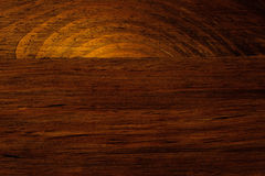Setting Sun Sinking into Ocean - Wood Grain Pattern. Image of setting sun sinking into ocean found in wood grain of a piece of furniture.  Horizon cuts the suns Stock Images