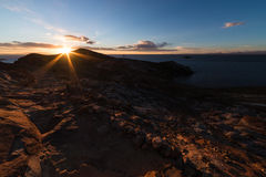 Setting sun on Titicaca Lake, Island of the Sun, Bolivia Royalty Free Stock Images
