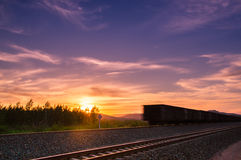 The setting sun. Under the setting sun sunset a speeding trainn and sunset Royalty Free Stock Photos