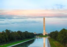 Setting sun on Washington monument reflecting Stock Photo